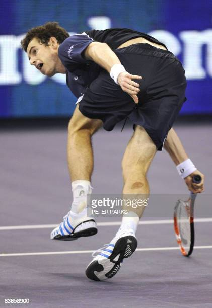 Andy Murray of Britain lunges for a return against Andy Roddick of the US in their singles match on the second day of the ATP Masters Cup tennis...