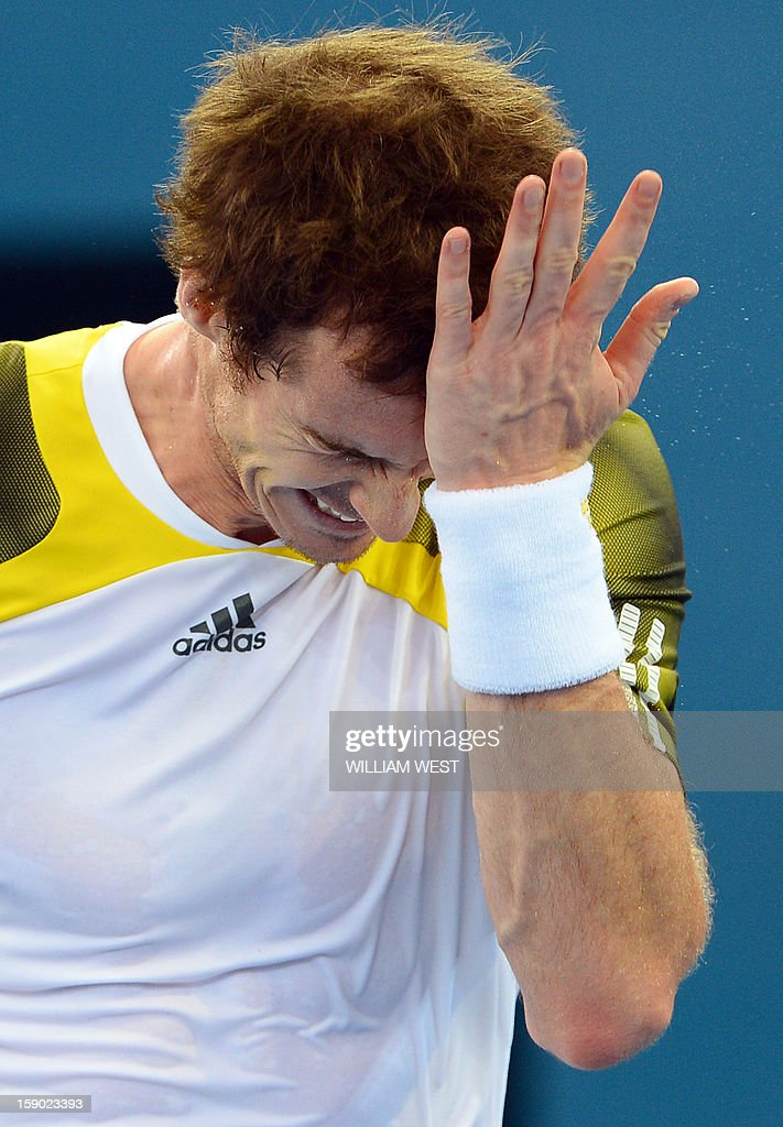 Andy Murray of Britain reacts while playing against Grigor Dimitrov of Bulgaria in the final of the Brisbane International tennis tournament on January 6, 2013. AFP PHOTO/William WEST USE