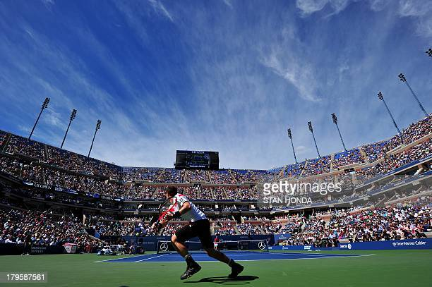 Andy Murray of Britain returns a shot to Stanislas Wawrinka of Switzerland during their 2013 US Open men's singles quarterfinal match at the USTA...