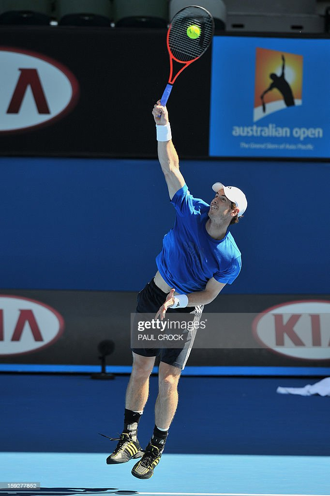 Andy Murray of Britain serves the ball during a practice session for the upcoming Australian Open tennis tournament in Melbourne on January 11, 2013. The first Grand Slam tennis tournament of the year is set to run from January 14 to 27. AFP PHOTO / Paul CROCK USE