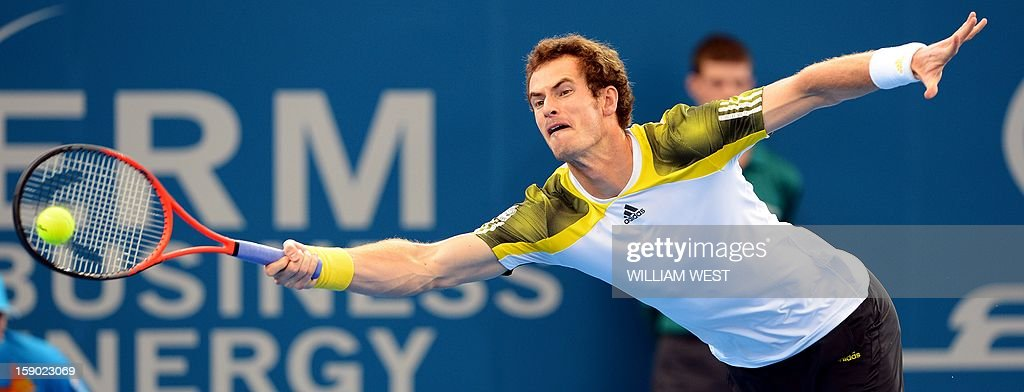 Andy Murray of Britain stretches to hit a forehand return on the way to defeating Grigor Dimitrov of Bulgaria in the final of the Brisbane International tennis tournament on January 6, 2013. AFP PHOTO/William WEST USE