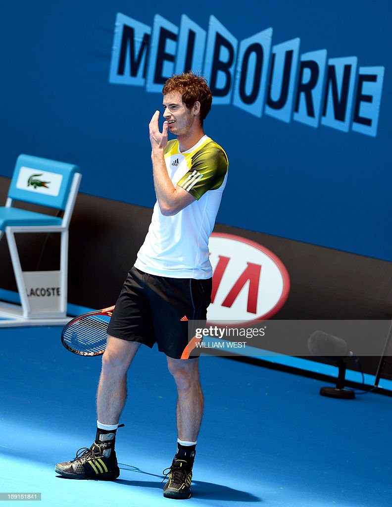 Andy Murray of Britain wipes the sweat away during a training session at Melbourne Park on January 9, 2013. Top players are arriving in Melbourne ahead of the Australian Open which runs January 14-27. AFP PHOTO/William WEST IMAGE RESTRICTED TO EDITORIAL USE - STRICTLY NO COMMERCIAL USE