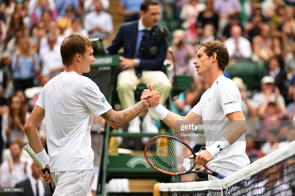 Andy Murray of Great Britain and Alexander Bublik of Kazakhstan shake hands after their Gentlemen's Singles first round match on day one of the Wimbledon Lawn Tennis Championships at the All England Lawn Tennis and Croquet Club on July 3, 2017 in London, England.