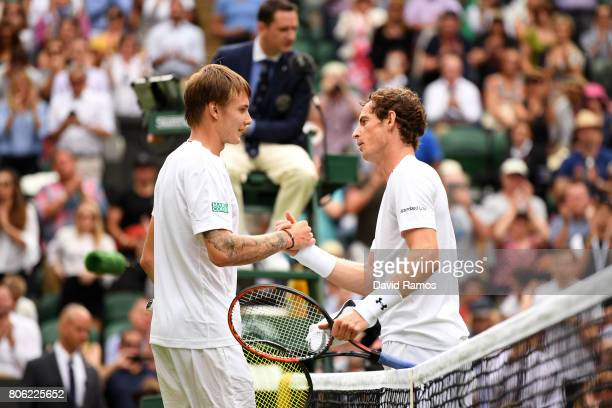 Andy Murray of Great Britain and Alexander Bublik of Kazakhstan shake hands after their Gentlemen's Singles first round match on day one of the...