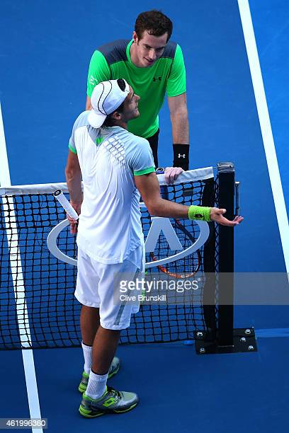 Andy Murray of Great Britain and and Joao Sousa of Portugal at the net in their third round match against during day five of the 2015 Australian Open...