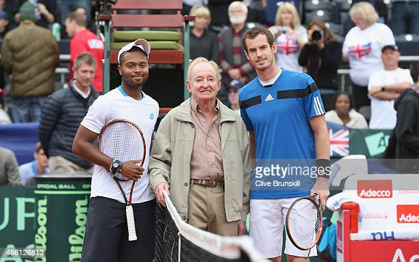 Andy Murray of Great Britain and Donald Young of the United States pose for a photgraph with Rod Laver who performed the pre match coin toss during...
