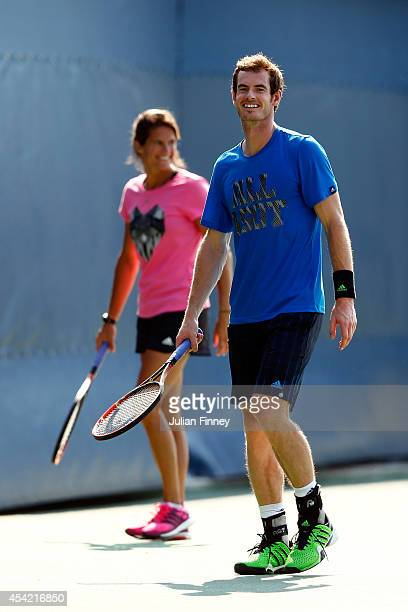 Andy Murray of Great Britain and his coach Amelie Mauresmo practice on Day Two of the 2014 US Open at the USTA Billie Jean King National Tennis...