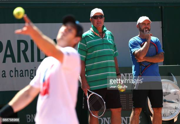 Andy Murray of Great Britain and his coach Ivan Lendl and assistant coach Jamie Delgado during practice two days ahead of the start of 2017 French...