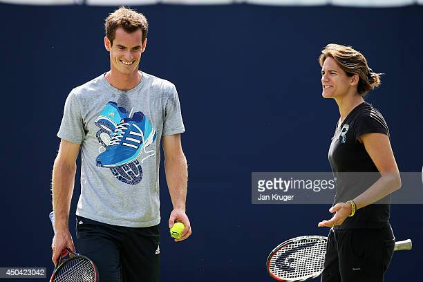Andy Murray of Great Britain and his new coach Amelie Mauresmo are seen together on the practice courts on day three of the Aegon Championships at...