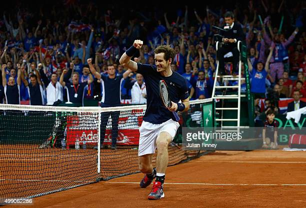 Andy Murray of Great Britain and Jamie Murray celebrate defeating Steve Darcis and David Goffin of Belgium in the doubles during day two of the Davis...