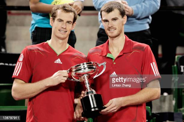 Andy Murray of Great Britain and Jamie Murray pose for photographers after beating Frantisek Cermak of Czech Republic and Filip Polasek of Slovakia...