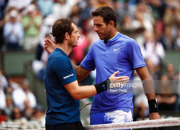 Andy Murray of Great Britain and Juan Martin Del Potro of Argentina embrace after the men's singles third round match during day seven of the French...