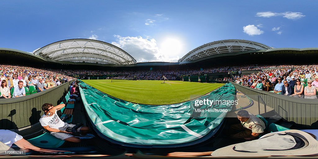 Andy Murray of Great Britain and Mikhail Youzhny of Russia during their Gentlemen's Singles fourth round match on day seven of the Wimbledon Lawn Tennis Championships at the All England Lawn Tennis and Croquet Club on July 1, 2013 in London, England.