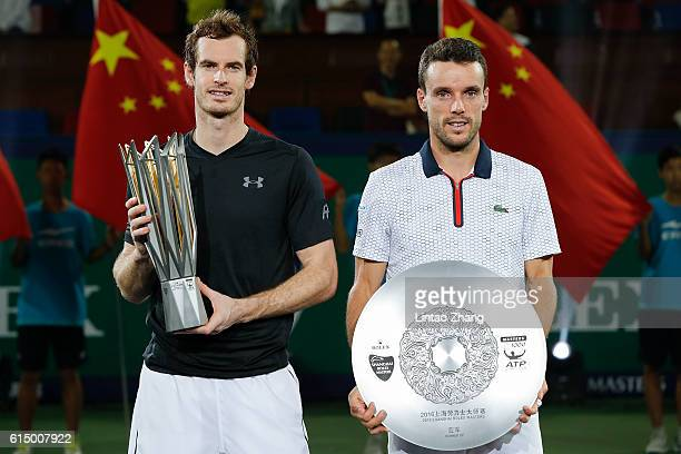 Andy Murray of Great Britain and Roberto Bautista Agut of Spain poses with their trophy after the Men's Single Final Match on day eight of Shanghai...