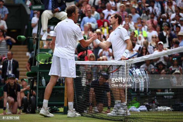 Andy Murray of Great Britain and Sam Querrey of The United States shake hands after the Gentlemen's Singles quarter final match on day nine of the...