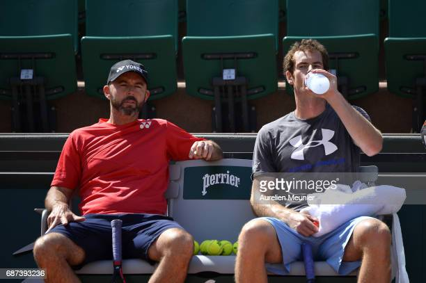 Andy Murray of Great Britain and the assistant Coach Jamie Delgado speak during a training session at the 2017 French Open at Roland Garros on May 23...