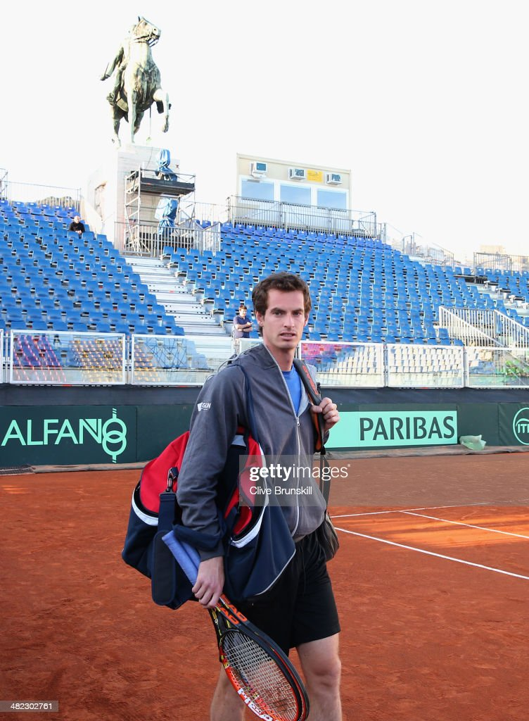 Andy Murray of Great Britain arrives on court for a late practice session prior to the Davis Cup World Group Quarter Final match between Italy and Great Britain at Tennis Club Napoli on April 3, 2014 in Naples, Italy.