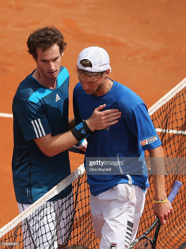 Andy Murray of Great Britain at the net after his straight sets victory over against <a gi-track='captionPersonalityLinkClicked' href=/galleries/search?phrase=Andreas+Seppi&family=editorial&specificpeople=228727 ng-click='$event.stopPropagation()'>Andreas Seppi</a> of Italy in the second rubber during day two of the Davis Cup World Group Quarter Final match between Italy and Great Britain at Tennis Club Napoli on April 5, 2014 in Naples, Italy.