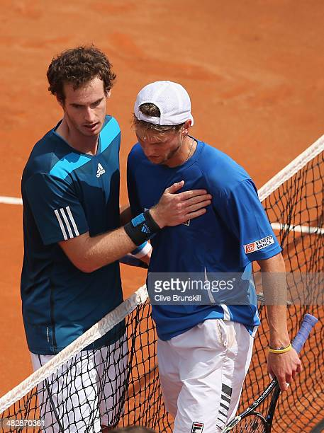 Andy Murray of Great Britain at the net after his straight sets victory over against Andreas Seppi of Italy in the second rubber during day two of...