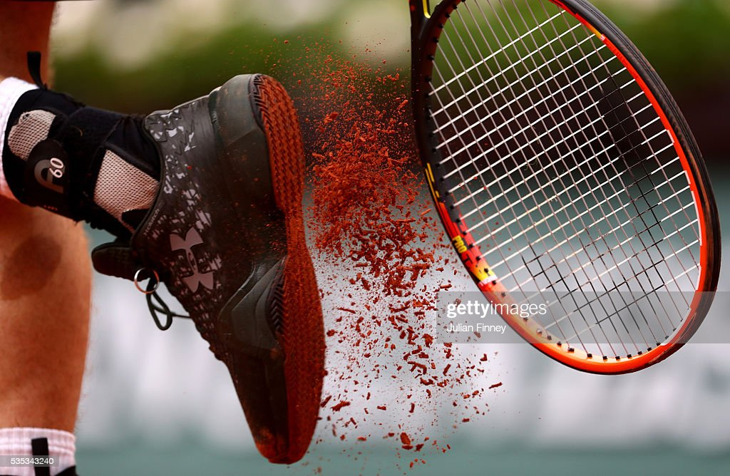 <a gi-track='captionPersonalityLinkClicked' href=/galleries/search?phrase=Andy+Murray+-+Tennis+Player&family=editorial&specificpeople=200668 ng-click='$event.stopPropagation()'>Andy Murray</a> of Great Britain bangs clay from his shoes during the Men's Singles fourth round match against John Isner of the United States on day eight of the 2016 French Open at Roland Garros on May 29, 2016 in Paris, France.