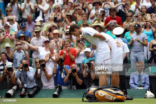 Andy Murray of Great Britain bows for Queen Elizabeth II ahead of his second round match against Jarkko Nieminen of Finland on Day Four of the...