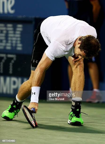 Andy Murray of Great Britain breaks his racket while playing against Kevin Anderson of South Africa during their Men's Singles Fourth Round match on...