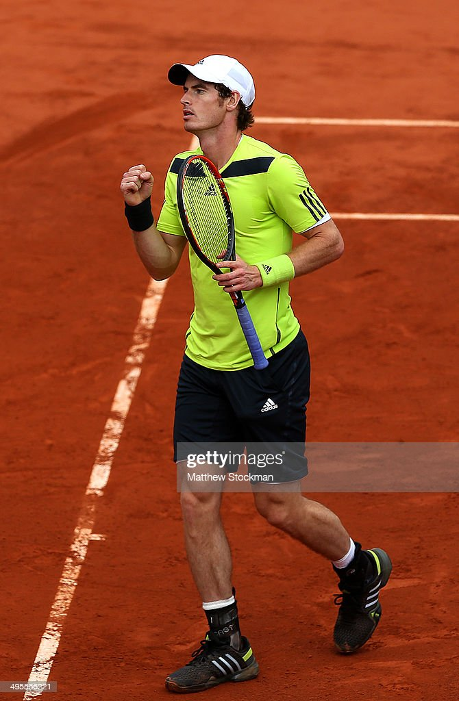Andy Murray of Great Britain celebrates a point during his men's singles quarter-final match against Gael Monfils of France on day eleven of the French Open at Roland Garros on June 4, 2014 in Paris, France.