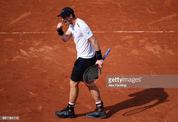Andy Murray of Great Britain celebrates a point during the mens singles second round match against Martin Klizan of Slovakia on day five of the 2017...