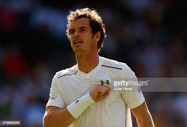 Andy Murray of Great Britain celebrates a point in his Gentlemen's Singles Fourth Round match against Ivo Karlovic of Croatia during day seven of the...