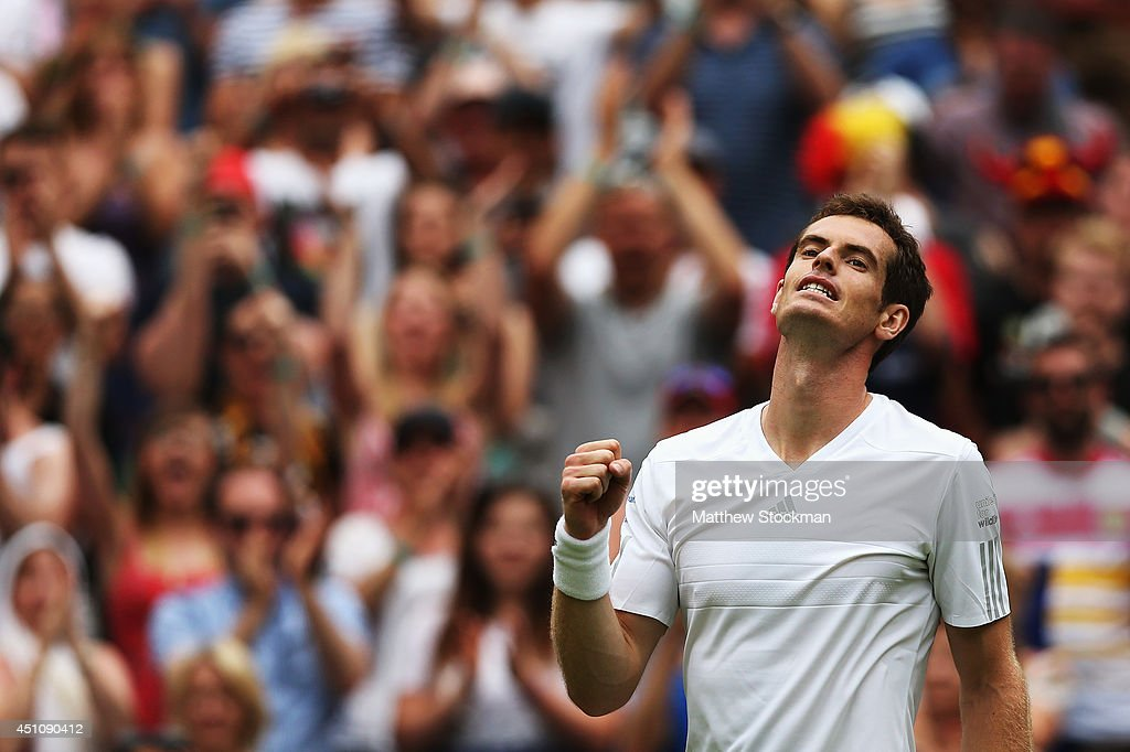 Andy Murray of Great Britain celebrates after winning his Gentlemen's Singles first round match against David Goffin of Belgium on day one of the Wimbledon Lawn Tennis Championships at the All England Lawn Tennis and Croquet Club at Wimbledon on June 23, 2014 in London, England.