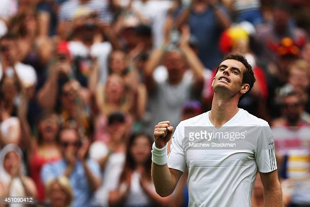 Andy Murray of Great Britain celebrates after winning his Gentlemen's Singles first round match against David Goffin of Belgium on day one of the...