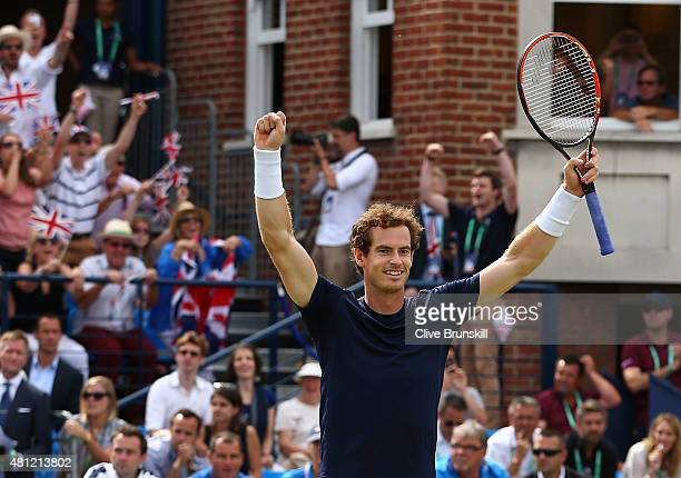 Andy Murray of Great Britain celebrates after winning his match with Jamie Murray of Great Britain against Nicolas Mahut and JoWilfried Tsonga of...