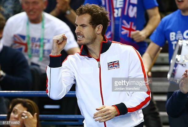 Andy Murray of Great Britain celebrates as Daniel Evans of Great Britain levels it at 55 in the second set during the singles match against Kei...
