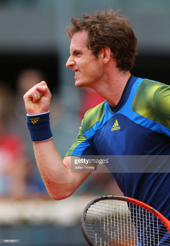 <a gi-track='captionPersonalityLinkClicked' href=/galleries/search?phrase=Andy+Murray+-+Tennis+Player&family=editorial&specificpeople=200668 ng-click='$event.stopPropagation()'>Andy Murray</a> of Great Britain celebrates at match point against Florian Mayer of Germany during day four of the Mutua Madrid Open tennis tournament at the Caja Magica on May 7, 2013 in Madrid, Spain.