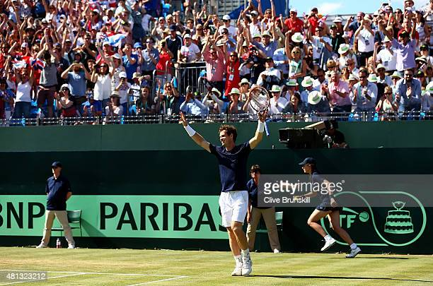 Andy Murray of Great Britain celebrates defeating Gilles Simon of France on Day Three of The World Group Quarter Final Davis Cup match between Great...