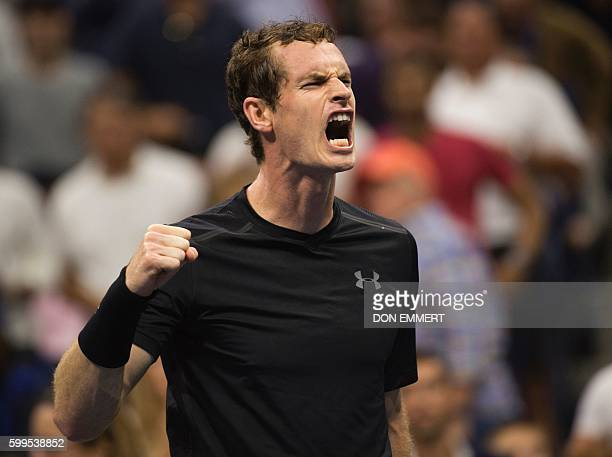 TOPSHOT Andy Murray of Great Britain celebrates his victory against Grigor Dimitrov of Bulgaria during their 2016 US Open men's singles match at the...