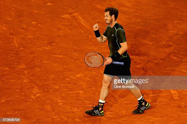 Andy Murray of Great Britain celebrates match point against Milos Raonic of Canada in their quarter final match during day seven of the Mutua Madrid...