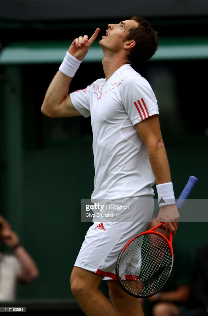 Andy Murray of Great Britain celebrates match point during his Gentlemen's Singles first round match against Nikolay Davydenko of Russia on day two of the Wimbledon Lawn Tennis Championships at the All England Lawn Tennis and Croquet Club on June 26, 2012 in London, England.
