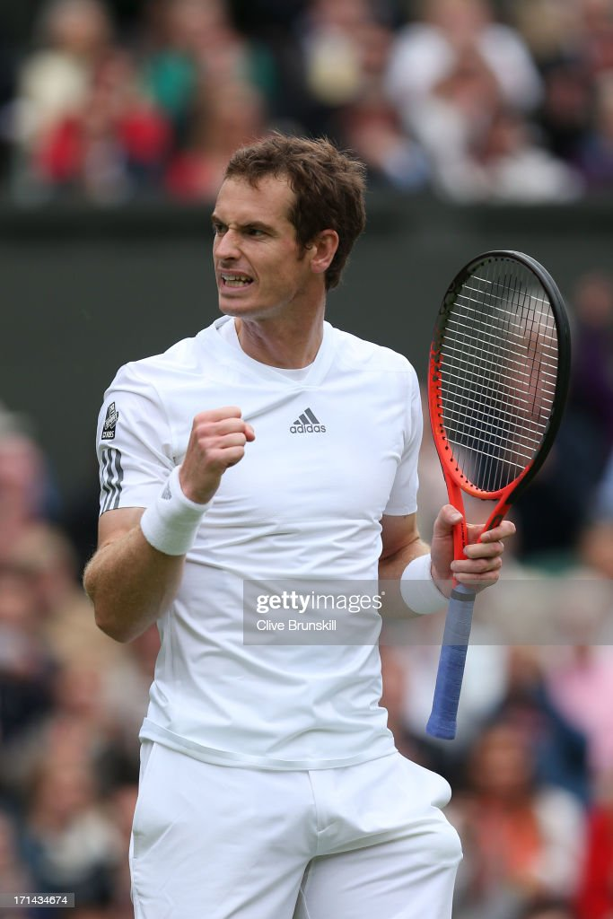 Andy Murray of Great Britain celebrates match point during his Gentlemen's Singles first round match against Benjamin Becker of Germany on day one of the Wimbledon Lawn Tennis Championships at the All England Lawn Tennis and Croquet Club on June 24, 2013 in London, England.