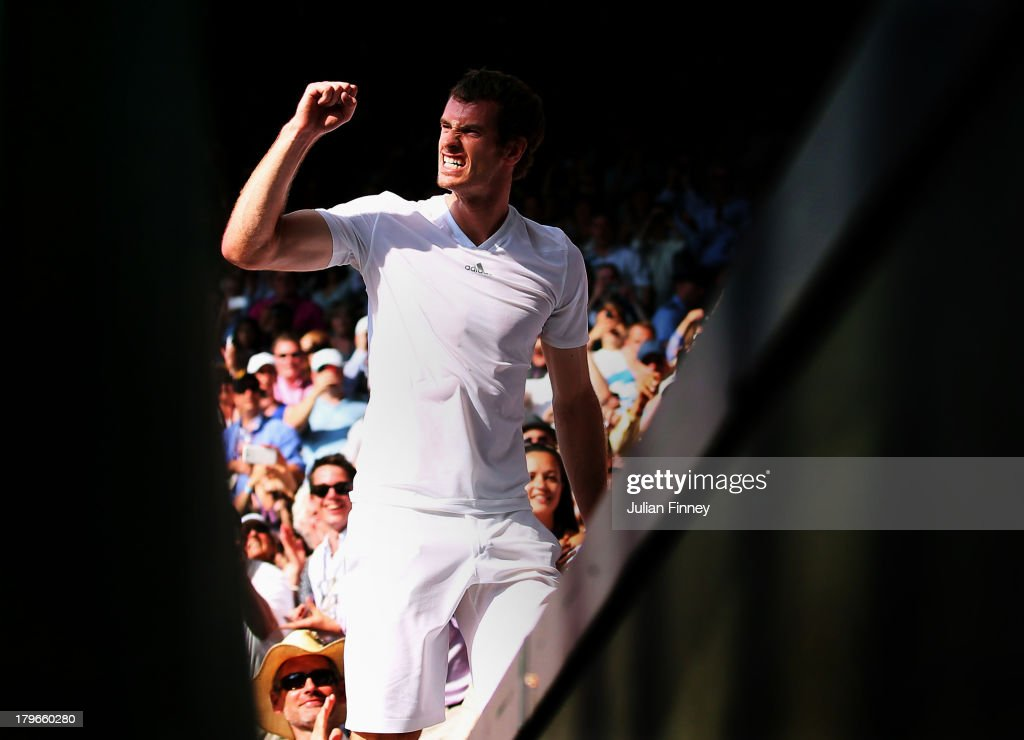 Andy Murray (R) of Great Britain celebrates on his way to his player's box with friends, family and members of his coaching team following his victory in the Gentlemen's Singles Final match against Novak Djokovic of Serbia on day thirteen of the Wimbledon Lawn Tennis Championships at the All England Lawn Tennis and Croquet Club on July 7, 2013 in London, England.