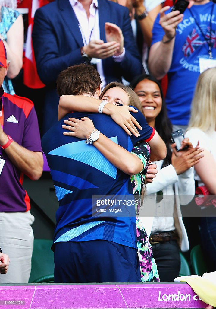 Andy Murray of Great Britain celebrates over Roger Federer of Switzerland with his girlfriend Kim Sears during the Men's Singles Tennis Gold Medal Match on Day 9 of the London 2012 Olympic Games, at the All England Lawn Tennis and Croquet Club on August 5, 2012 in London, England.