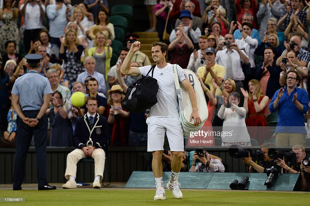 <a gi-track='captionPersonalityLinkClicked' href=/galleries/search?phrase=Andy+Murray+-+Tennis+Player&family=editorial&specificpeople=200668 ng-click='$event.stopPropagation()'>Andy Murray</a> of Great Britain celebrates victory as he leaves Centre Court following his victory in the Gentlemen's Singles semi-final match against Jerzy Janowicz of Poland on day eleven of the Wimbledon Lawn Tennis Championships at the All England Lawn Tennis and Croquet Club on July 5, 2013 in London, England.