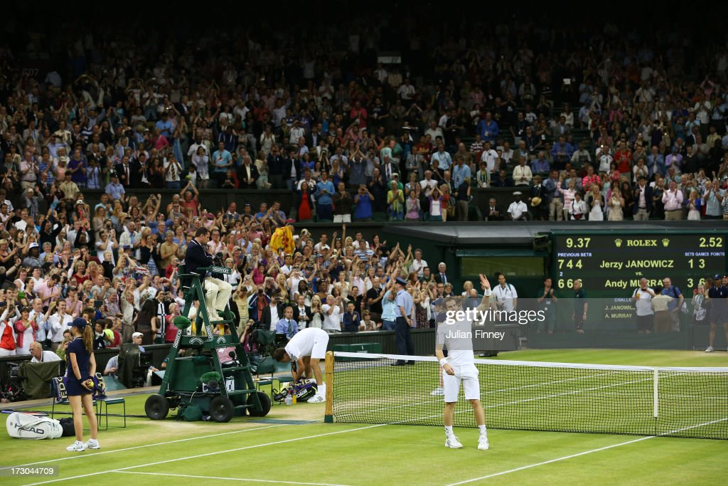 <a gi-track='captionPersonalityLinkClicked' href=/galleries/search?phrase=Andy+Murray+-+Tennis+Player&family=editorial&specificpeople=200668 ng-click='$event.stopPropagation()'>Andy Murray</a> of Great Britain celebrates victory as <a gi-track='captionPersonalityLinkClicked' href=/galleries/search?phrase=Jerzy+Janowicz&family=editorial&specificpeople=4482863 ng-click='$event.stopPropagation()'>Jerzy Janowicz</a> of Poland prepares to leave Centre Court following their Gentlemen's Singles semi-final match on day eleven of the Wimbledon Lawn Tennis Championships at the All England Lawn Tennis and Croquet Club on July 5, 2013 in London, England.