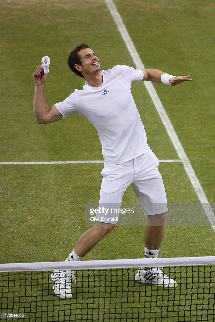 Andy Murray of Great Britain celebrates victory during the Gentlemen's Singles semi-final match against Jerzy Janowicz of Poland on day eleven of the Wimbledon Lawn Tennis Championships at the All England Lawn Tennis and Croquet Club on July 5, 2013 in London, England.