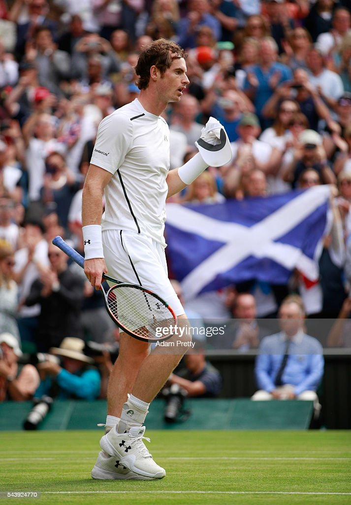 Andy Murray of Great Britain celebrates victory during the Men's Singles second round match against Yen-Hsun Lu of Taipei on day four of the Wimbledon Lawn Tennis Championships at the All England Lawn Tennis and Croquet Club on June 30, 2016 in London, England.