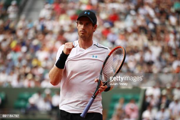 Andy Murray of Great Britain celebrates victory during the men's singles second round match against Martin Klizan of Slovakia on day five of the 2017...