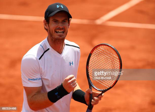 Andy Murray of Great Britain celebrates victory during the men's singles fourth round match against Karen Khachanov of Russia on day nine of the 2017...