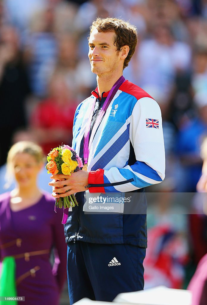 Andy Murray of Great Britain celebrates victory over Roger Federer of Switzerland during the Men's Singles Tennis Gold Medal Match on Day 9 of the London 2012 Olympic Games, at the All England Lawn Tennis and Croquet Club on August 5, 2012 in London, England.