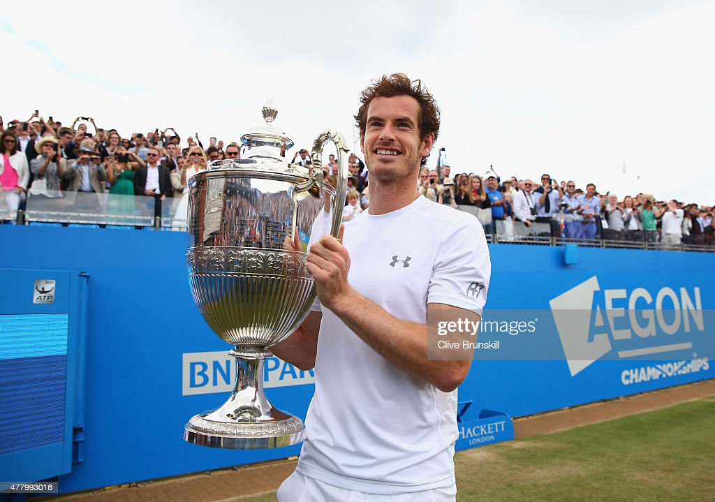 Andy Murray of Great Britain celebrates victory with the trophy after his men's singles final match against Kevin Anderson of South Africa during day...
