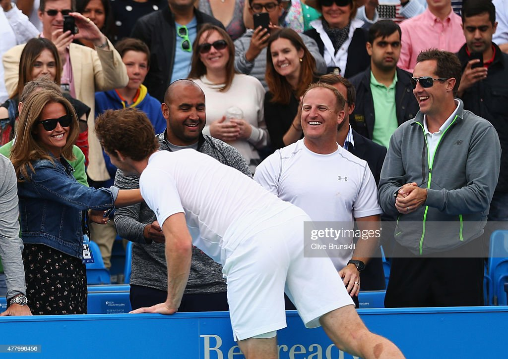 Andy Murray of Great Britain celebrates victory with wife Kim Murray as coach Jonas Bjorkman (R) looks on after his men's singles final match against Kevin Anderson of South Africa during day seven of the Aegon Championships at Queen's Club on June 21, 2015 in London, England.